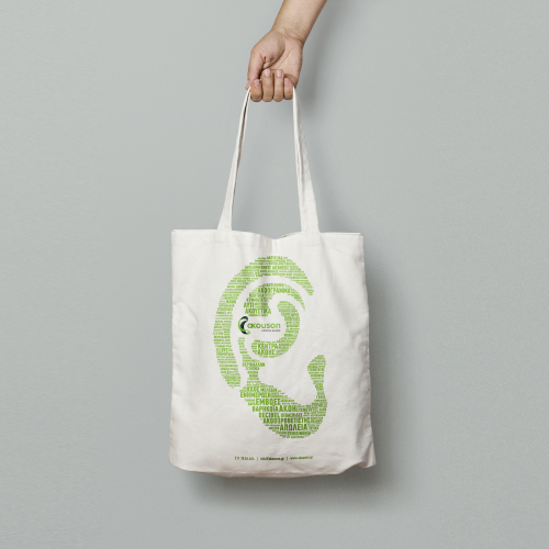 Tote Bag with hearing-related words that form a big ear