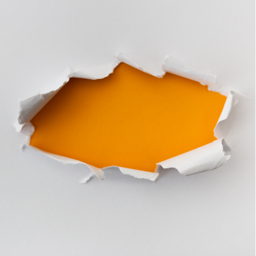 White torn paper with yellow shadow background